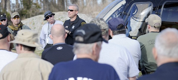 Trooper M. Horne explains helicopter operations to Search and Rescue teams